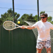 Royalty-Free Stock Photo: Middle age man playing tennis