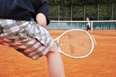 Young man playing tennis — Stock Photo