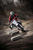 Motocross slalom bike on dirty ground — Stock Photo