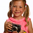 Young girl holding an old film camera — Stock Photo