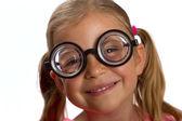 Girl wearing big glasses — Stock Photo