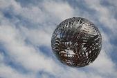 Metal fern ball in the sky — Stock Photo