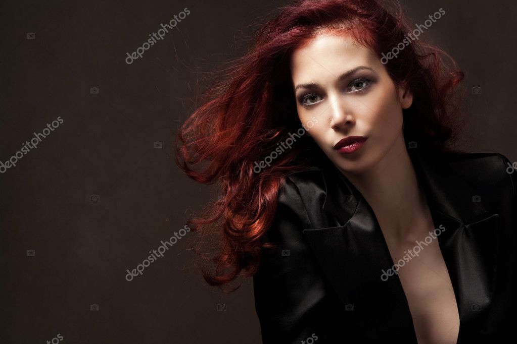 Beautiful red hair elegant woman portrait, studio shot  Stock Photo #3095772