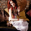 Red hair woman relaxing on sofa - Stock Photo