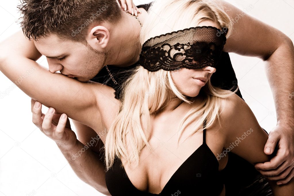 Young masked couple in love, studio shot on white — Stock Photo #3174775