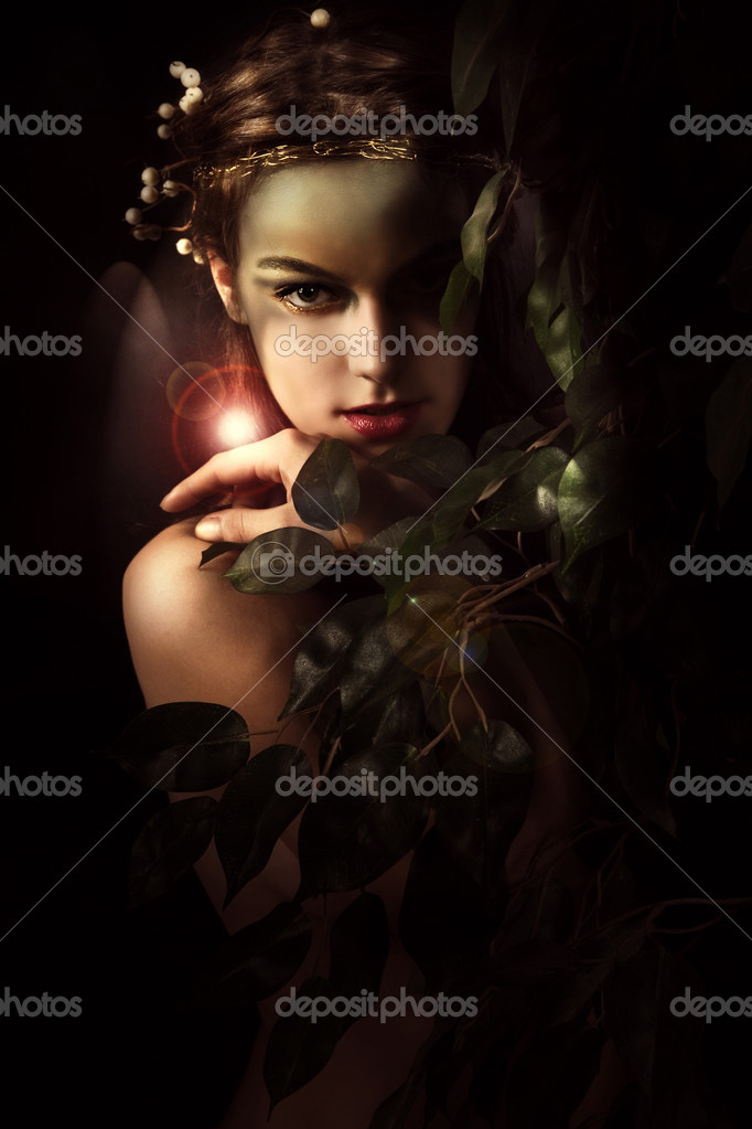 Young woman styled as a forest nymph, studio shot — Stock Photo #3174826