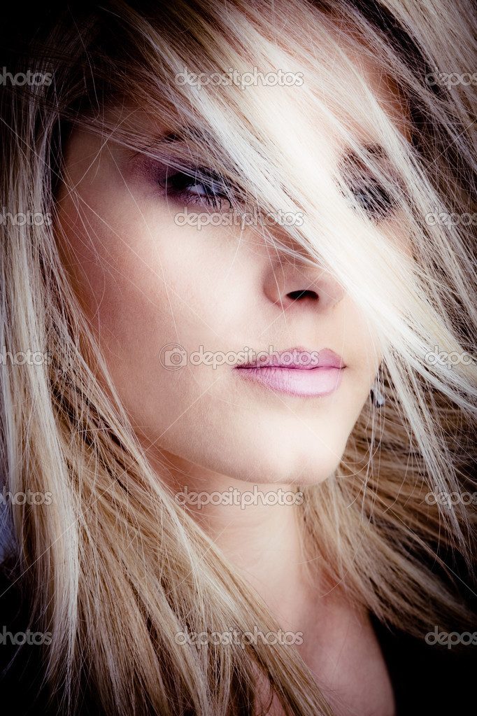 Blond woman portrait with hair over face  Stok fotoraf #3174910