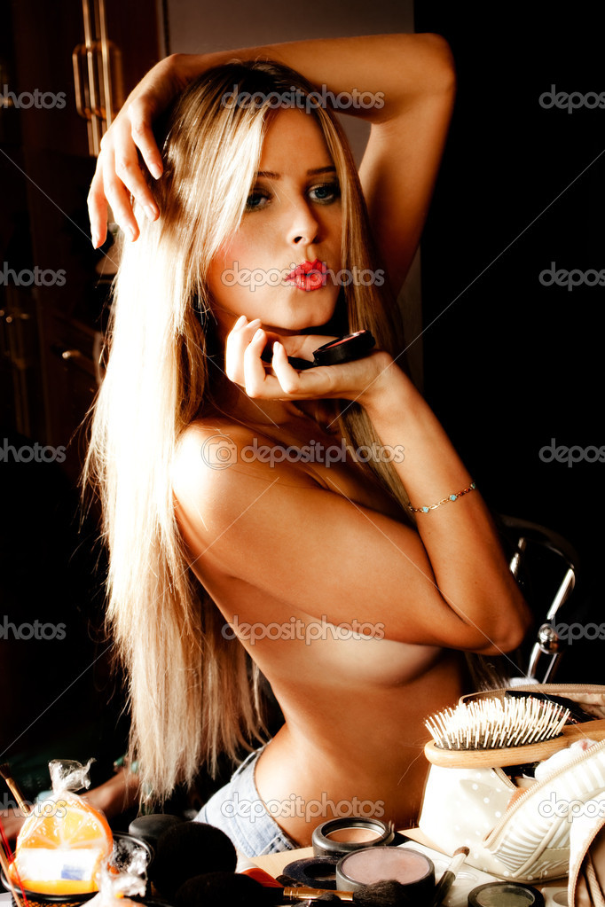 Sensual blond woman in front mirror with make up accessories, indoor shot — Stock Photo #3175997