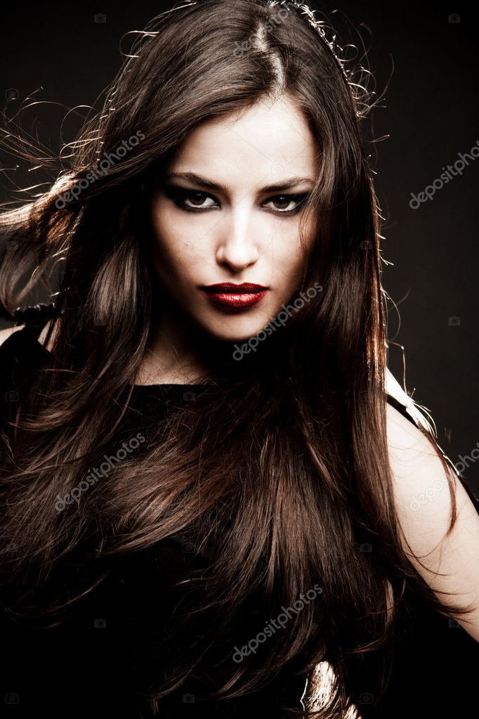 Young brunette woman portrait, studio shot  Stock Photo #3176361