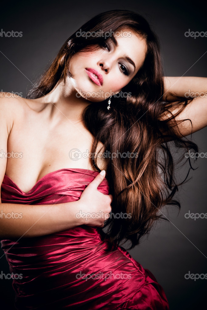 Beautiful sensual brunette in elegant dress, studio shot  Stock Photo #3176426