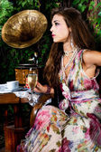Woman and old gramophone — Stock Photo