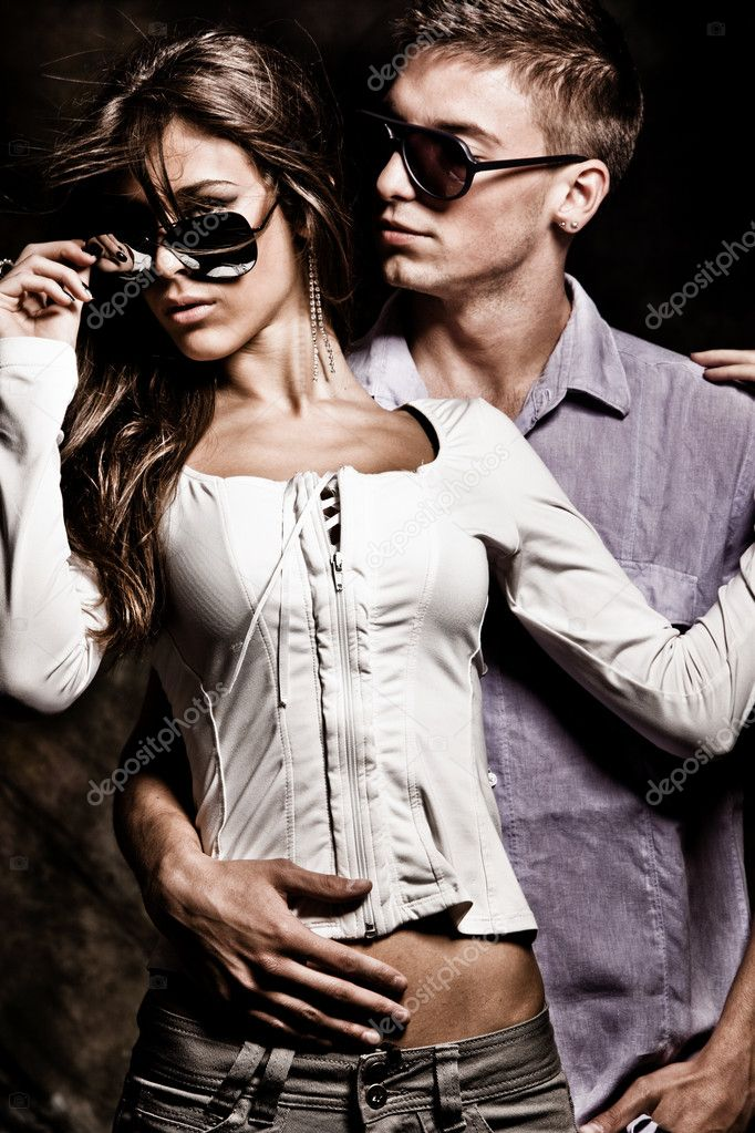 Young couple with sunglasses, studio shot  Stock Photo #3453565