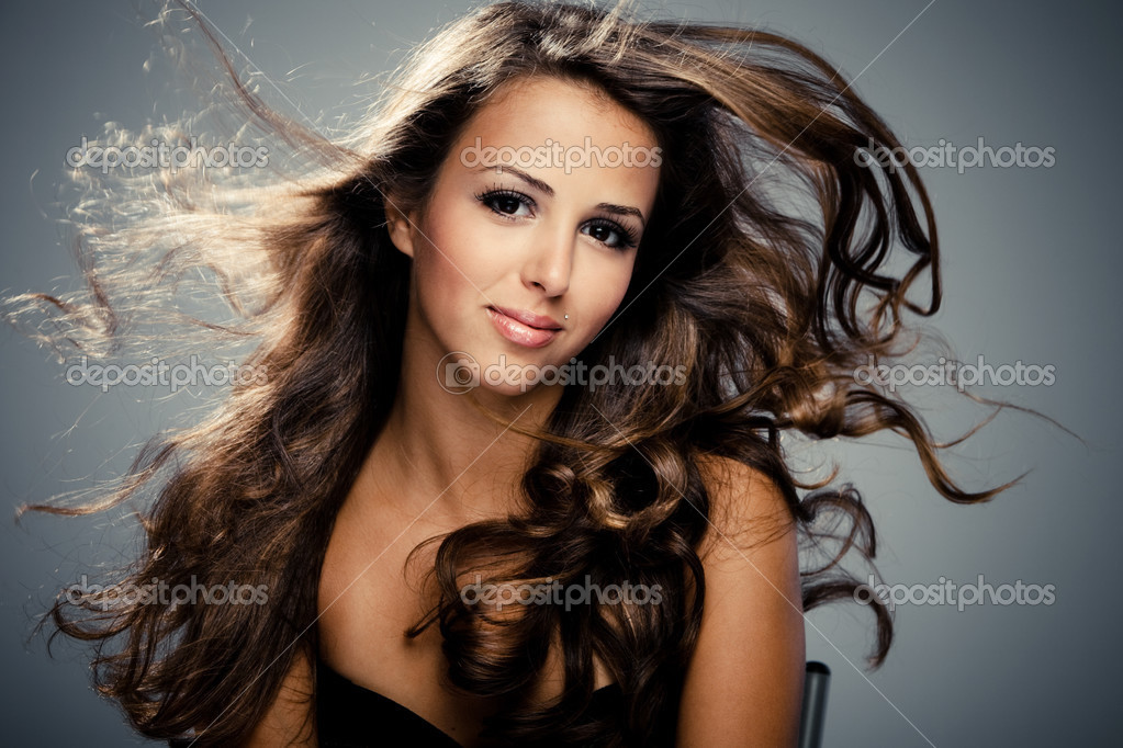 Young brunette  woman with long flying hair, studio shot — Stock Photo #3520861