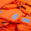 Pile of orange life-jackets — Stock Photo