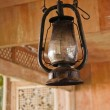 Petroleum lamp in old wooden house — Stock Photo