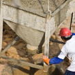 Stock Photo: Construction worker pouring concrete (1)