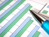Bar chart with pen — Stock Photo