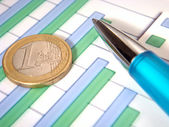 Bar chart with pen and euro coin — Stock Photo