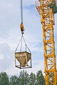 Concrete pourer hanging from crane — Stock Photo