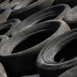 Stock Photo: Pile of discarded tyres (2)