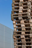 Euro pallets in front of building — Stok fotoğraf
