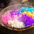 Stock Photo: Five-coloured rice in bamboo steamer