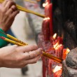 Stock Photo: Lighting incense sticks (1)