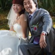 Smiling bride and groom in park (1) — Stock Photo #3187688