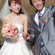Stock Photo: Attractive bride and groom waving