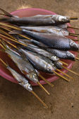 Barbecued fish on stick — Stock Photo