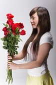 Cute asian girl accepting flowers — Stock Photo