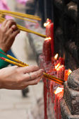 Lighting incense sticks (1) — Stock Photo