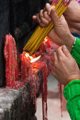 Lighting incense sticks (2) — Stock Photo