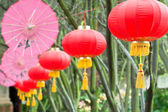 Pink umbrellas and chinese lanterns (2) — Stock Photo