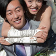 Beautiful bride on groom's back (1) — Stock Photo