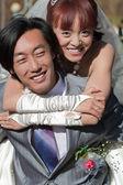 Beautiful bride on groom's back (1) — Stock Photo