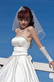 Beautiful bride in white on bridge (2) — Stock Photo