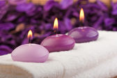 Purple candles on massage towel (1) — Stock Photo