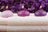 Purple candles on massage towel (3) — Stock Photo