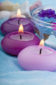 Purple toned candles and flowers (1) — Stock Photo
