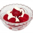 Strawberries with cream in a crystal vas — Stock Photo