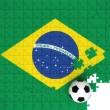 Soccer ball on puzzle Braziliflag — Stock Photo #3215552