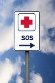 SOS billboard with arrow — Stock Photo