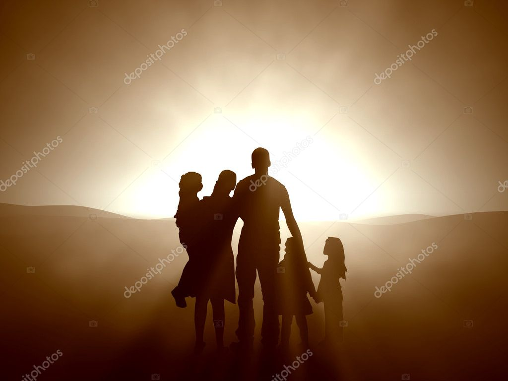 Silhouettes of a family looking towards the light.  Stock Photo #3203873