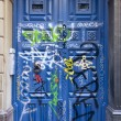 Graffiti on door — Stok fotoğraf