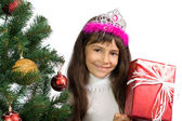 The girl with a New Year tree — Stock fotografie