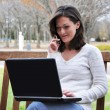 Female Student Using Computer Outside — Stock Photo #3157827