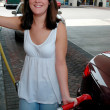 Smiling Girl Pumping Gas — Stock Photo