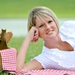 Royalty-Free Stock Photo: Young Blond Woman on Picnic with Wine