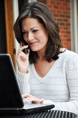 Female Student Using Computer and Cell Phone — Stock Photo